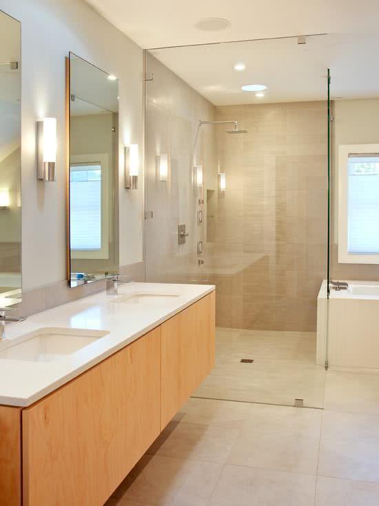 imagem u banheiro com preto e chuveiro com duas duchas