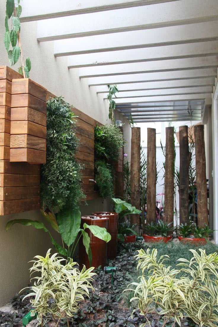 flores para jardim de inverno:Imagem 15 – Jardim de inverno na sala com clarabóia