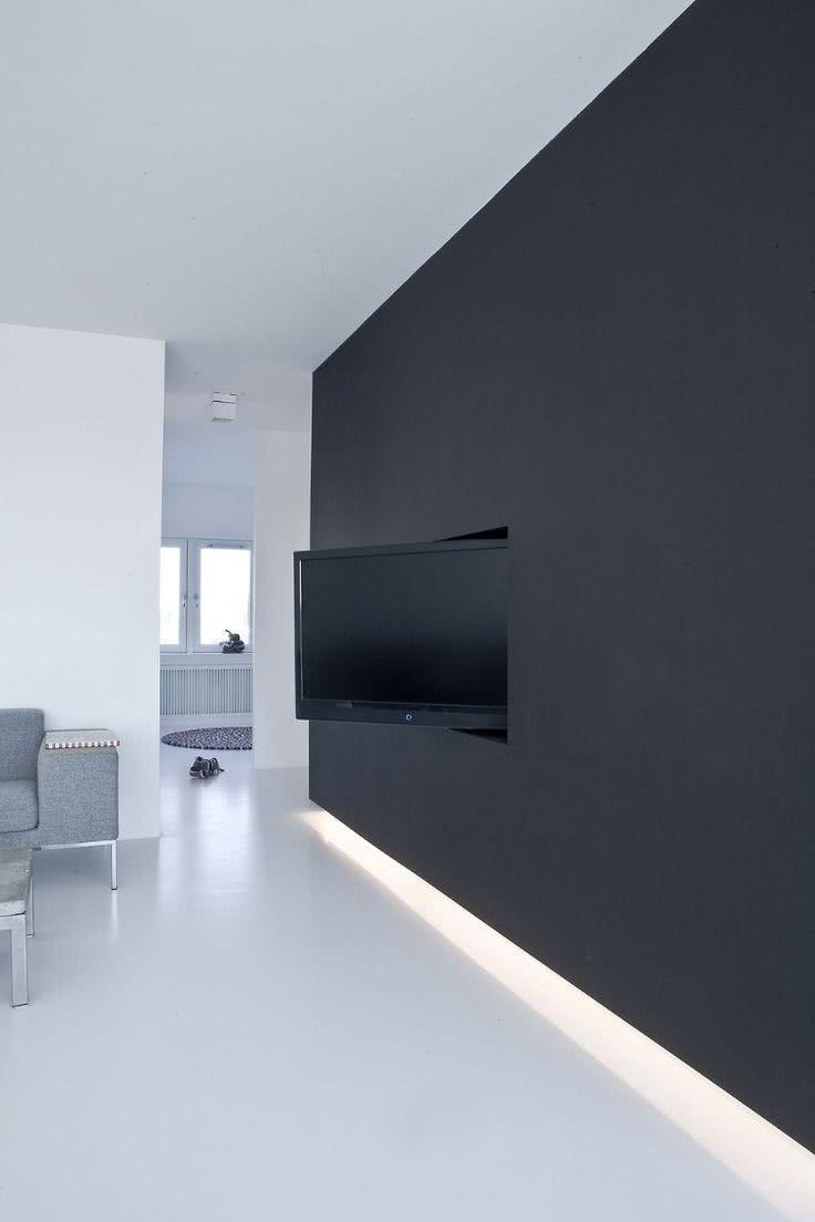 Sala com parede minimalista grafite