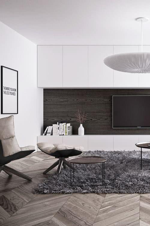 Sala moderna com TV de parede