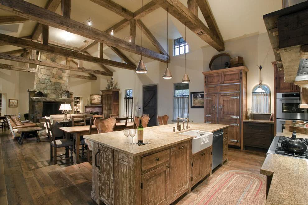Lindo espaço de convivência com cozinha americana, sala de jantar e estar.