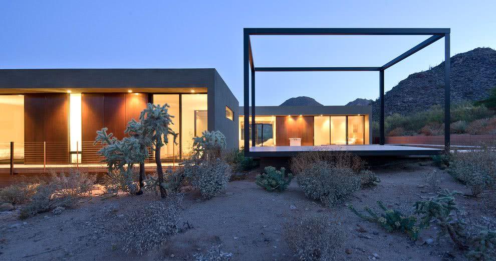 Projeto de casa com concreto e boa iluminação.
