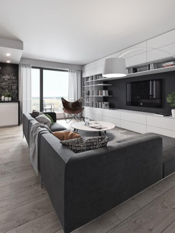 Sala com sofá e parede cinza / grafite