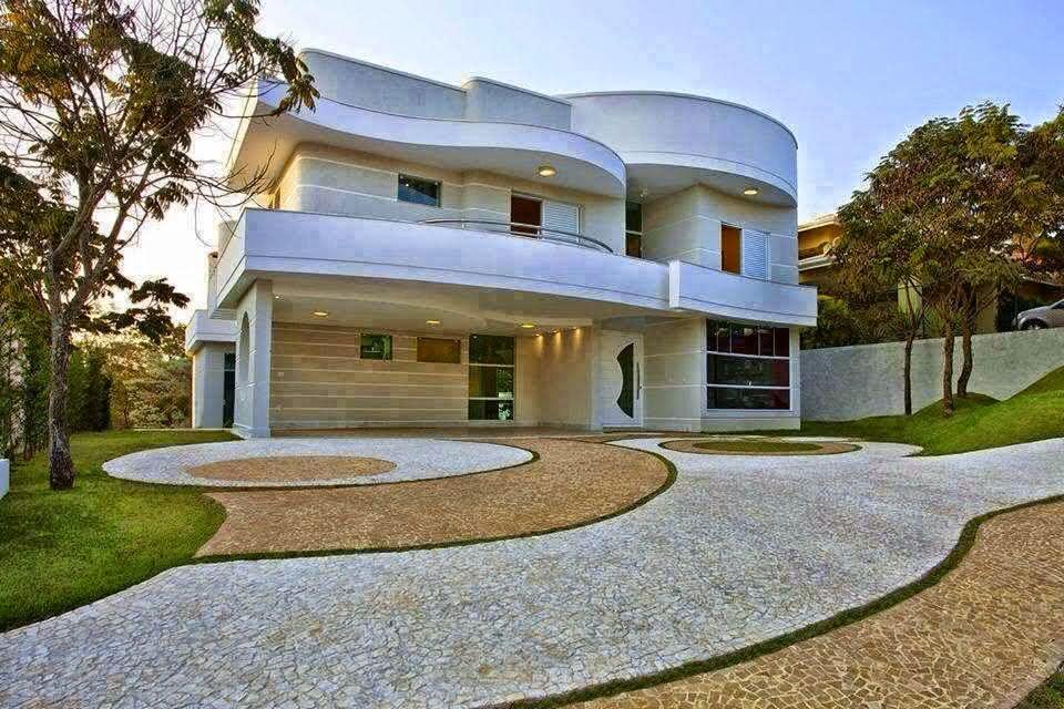 ideias jardins moradiasImagem 34 – Calçada residencial com pedra