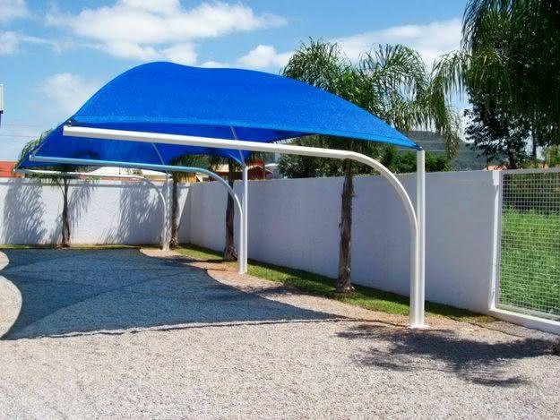 40 coberturas para garagens modelos e fotos for Tipos de toldos para patios