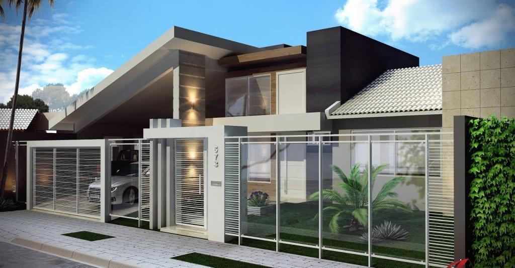 Portão residencial metálico e com detalhes em vidro