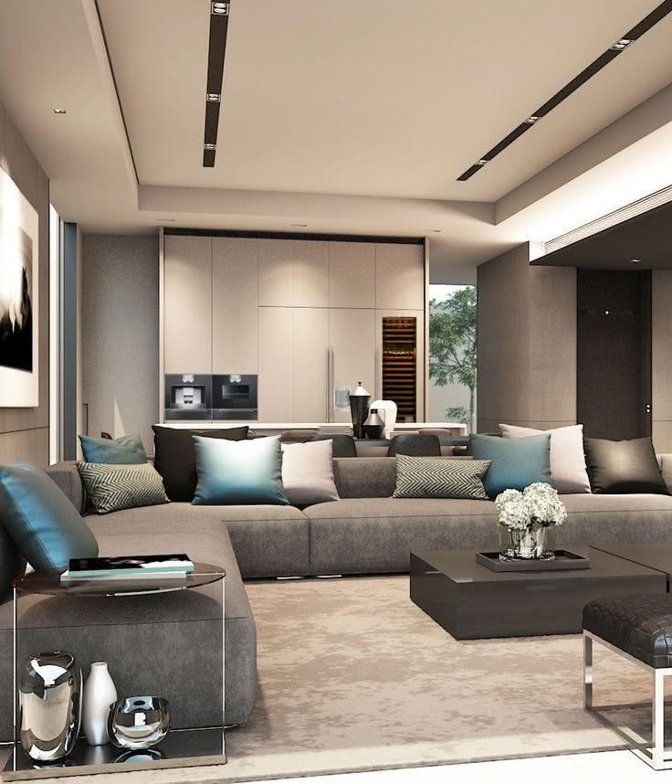 Sala De Estar Minimalista Moderno ~ Imagem 21 – Sala de estar moderna integrada a cozinha