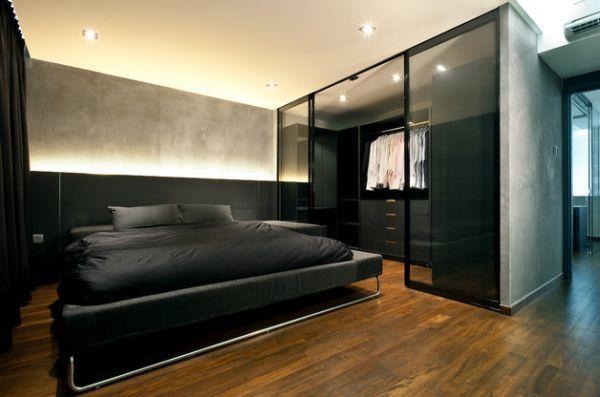 Um closet moderno para um quarto com cores sóbrias.