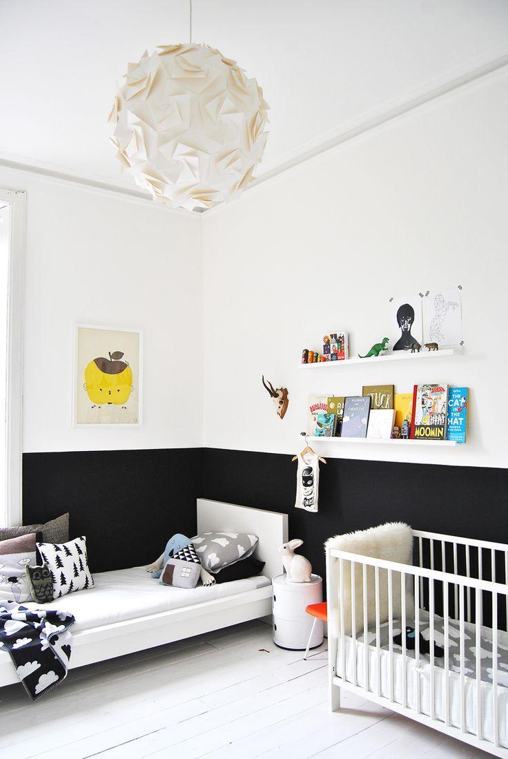 O preto e branco é uma boa dupla de cores para decorar o quarto do seu filho