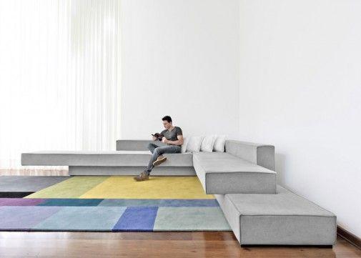 imagem u incorpore um sof neutro com almofadas para dar