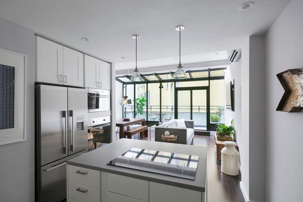 imagem u projeto de cozinha com ilha moderna prxima a sala de estar e jantar