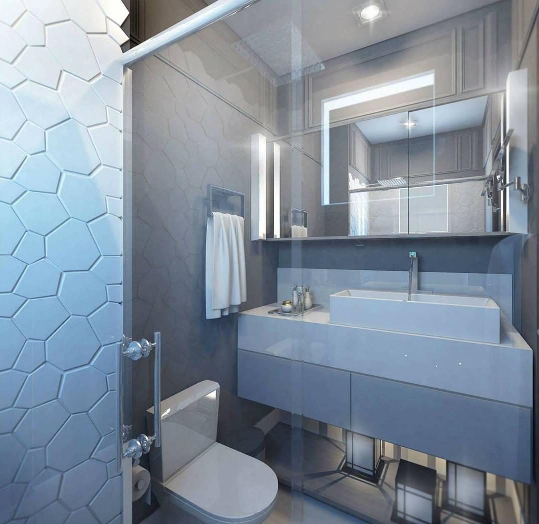 Banheiro pequeno com decoração moderna.