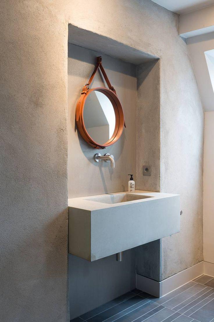 Banheiro moderno com o uso de concreto.