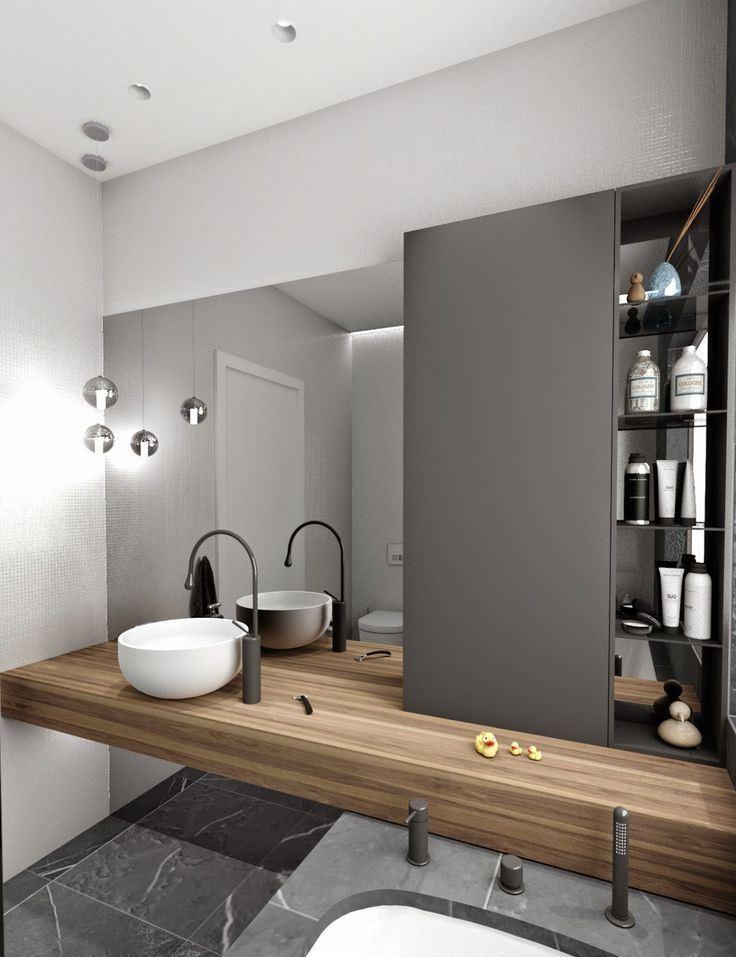 A bancada apoiada na banheira destaca o projeto do banheiro.