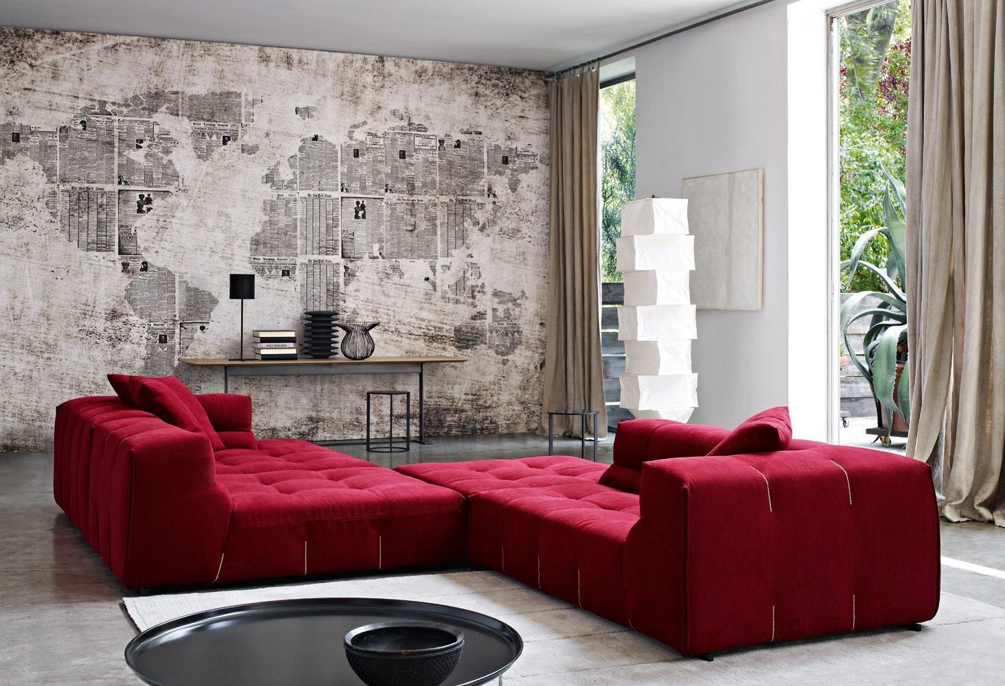 imagem u vermelho e cinza fazem a composio perfeita para uma sala de estar jovial