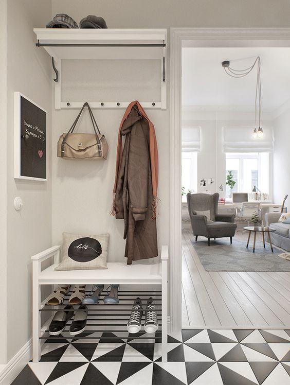 Delimite o hall de entrada com pisos diferentes