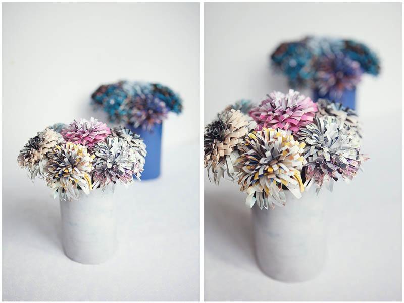 Flores feitas com tiras coloridas de jornal