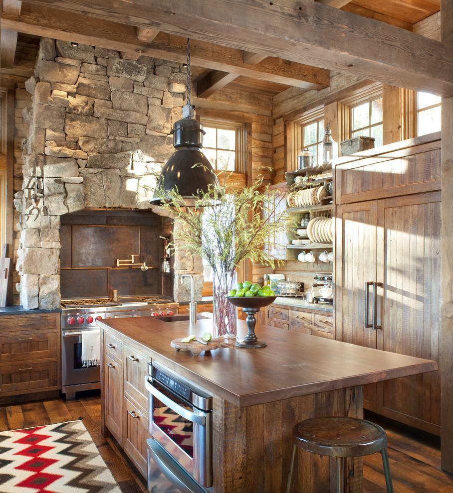 Fogão com exaustão na cozinha rústica
