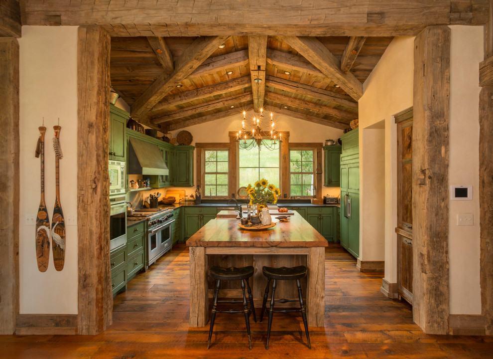 Projeto de cozinha rústica com armários na cor verde como destaque