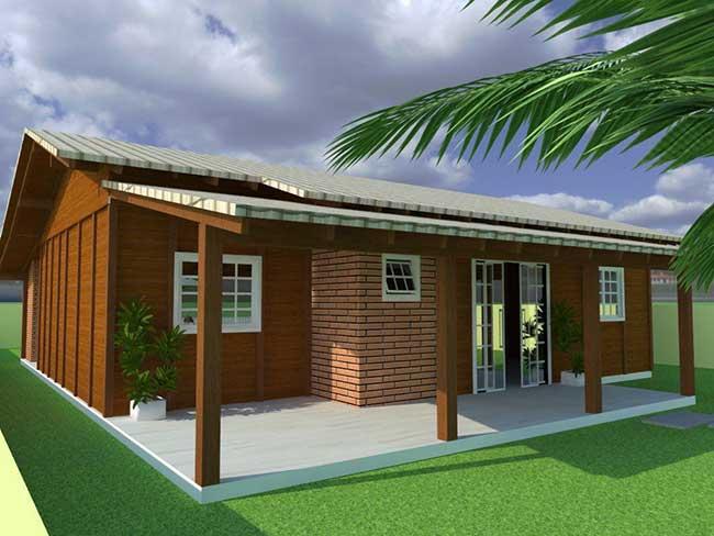 Casa de madeira simples com detalhe em tijolinho