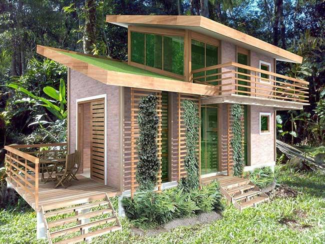 Chalé de madeira com sistema sustentável