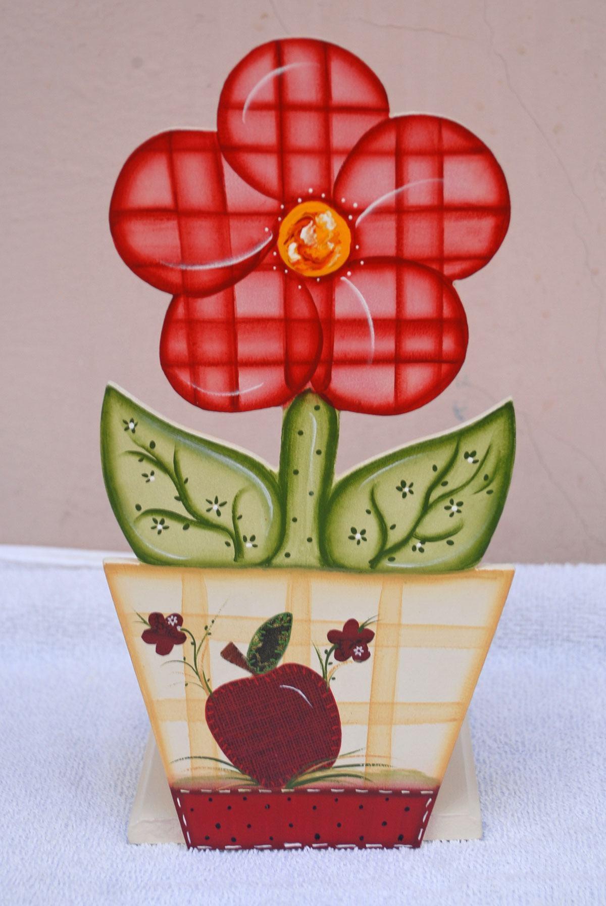 Placa decorativa que imita um vaso de flor rosa