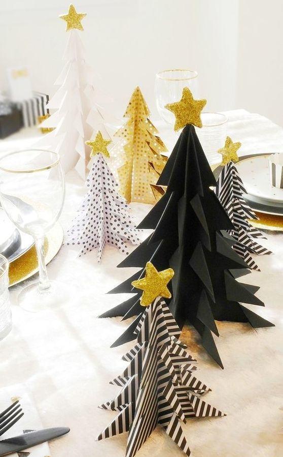 Árvores de papel com diferentes estampas: preto, preto e branco e dourado com bolinhas