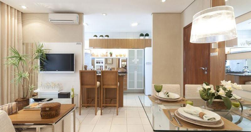 Sala integrada a cozinha com decoração clean