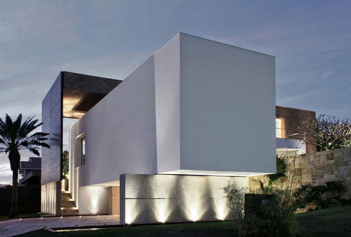 Casa moderna com caixa de concreto