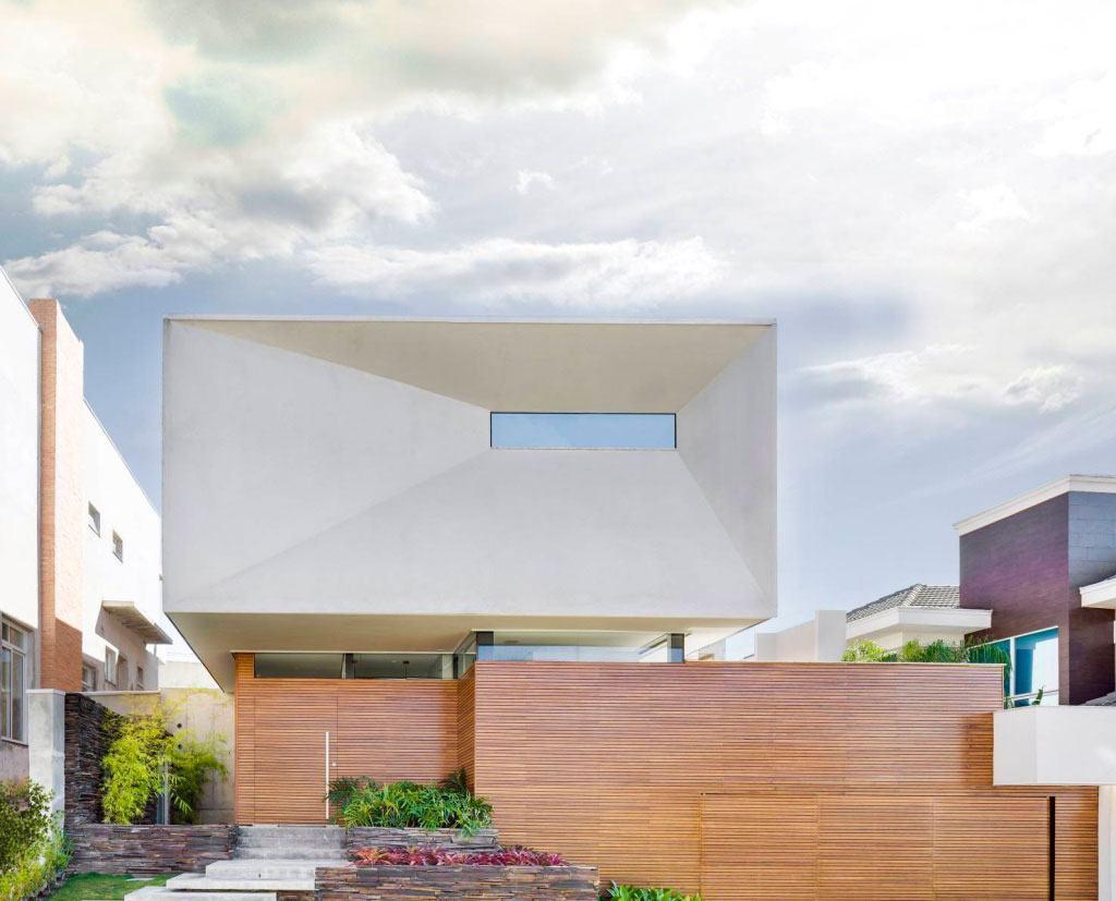 efeitos geométricos na fachada de casa com telhado embutido.