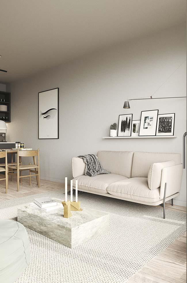 Mantas para sofá: ambiente de tons neutros ganhou uma manta que dá continuidade a proposta