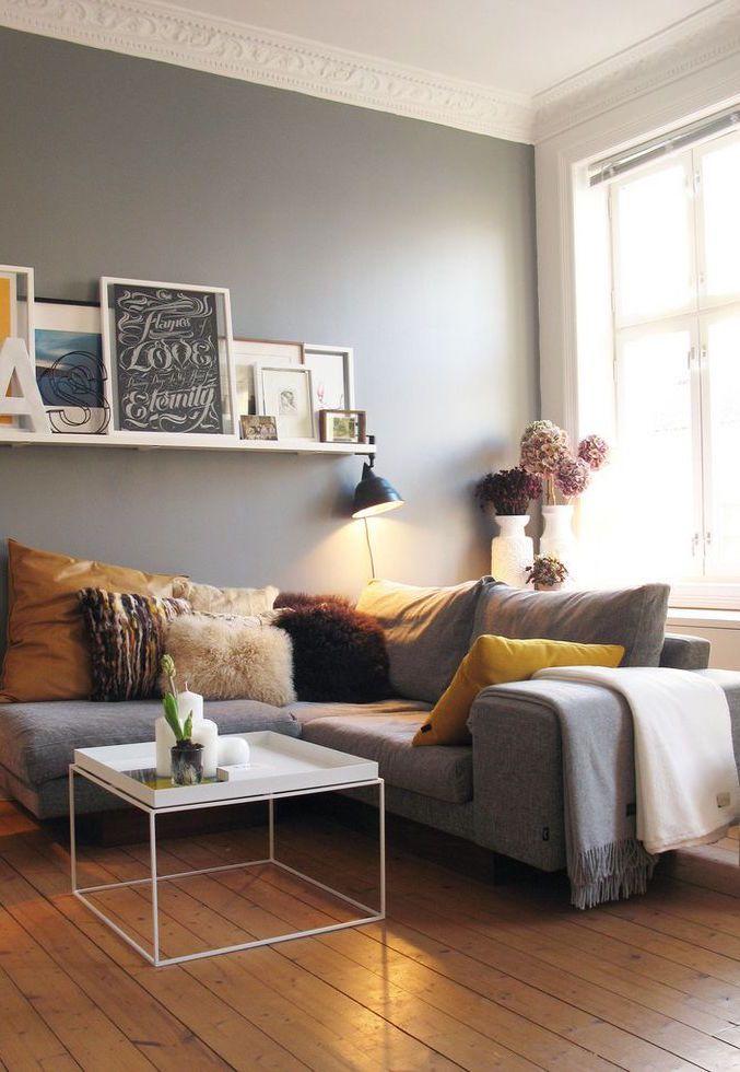 Mantas para sofá: modelo cinza de canto possui duas mantas estrategicamente posicionadas no braço