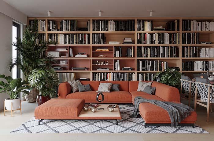 Manta cinza, da cor das almofadas, sobre o sofá cor de terracota