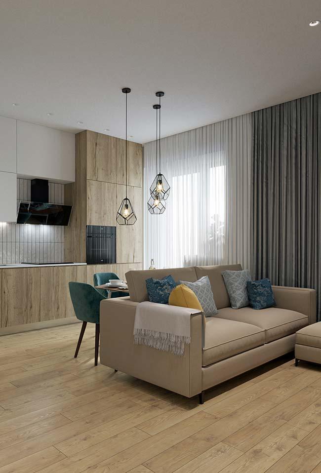 Mantas para sofá: no braço do sofá, a manta de tom neutro fica sempre à disposição para quem quiser descansar na sala