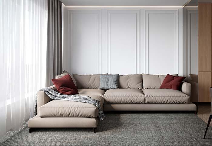 Manta cria volume e contraste para o sofá neutro