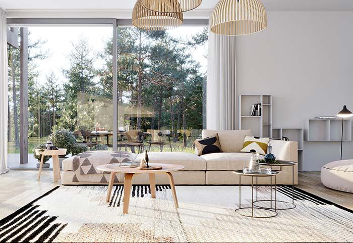 Mantas para sofá: nesse sofá longo, a manta marca o término do móvel