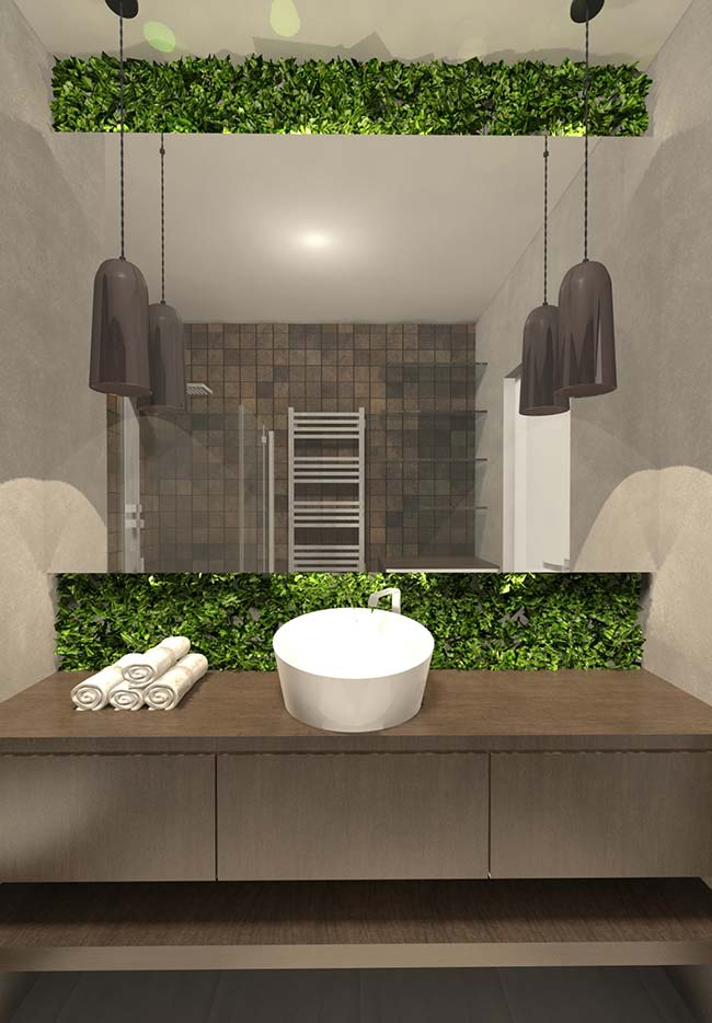 E no banheiro, atrás do espelho, eis que se revela uma linda e original proposta de jardim vertical