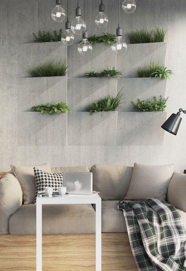 Nessa sala, jardim vertical e parede unem-se em uma coisa só