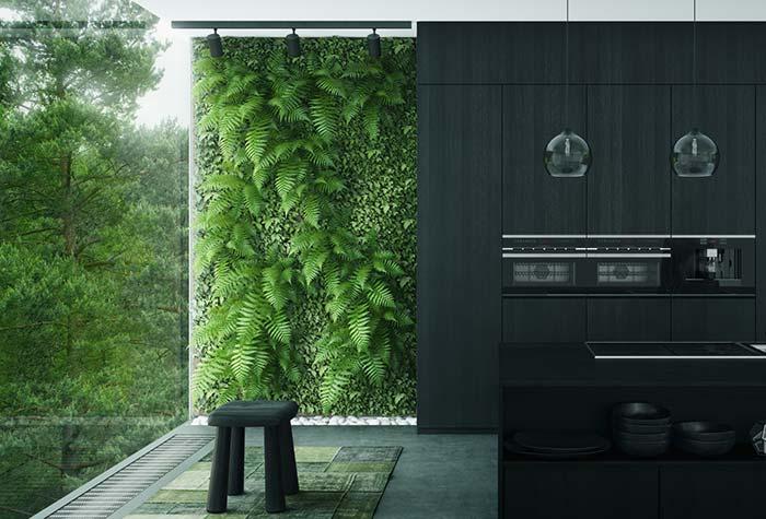 Jardim vertical traz cor e contraste para essa casa de estilo minimalista