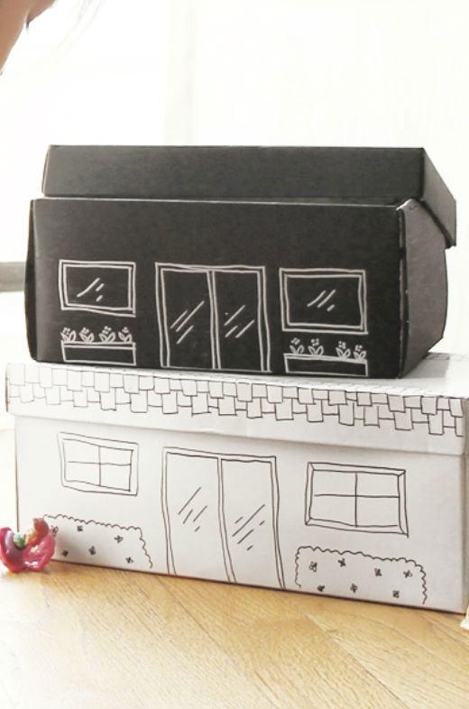 Crie casinhas pintando as caixas com desenhos de canetinha.