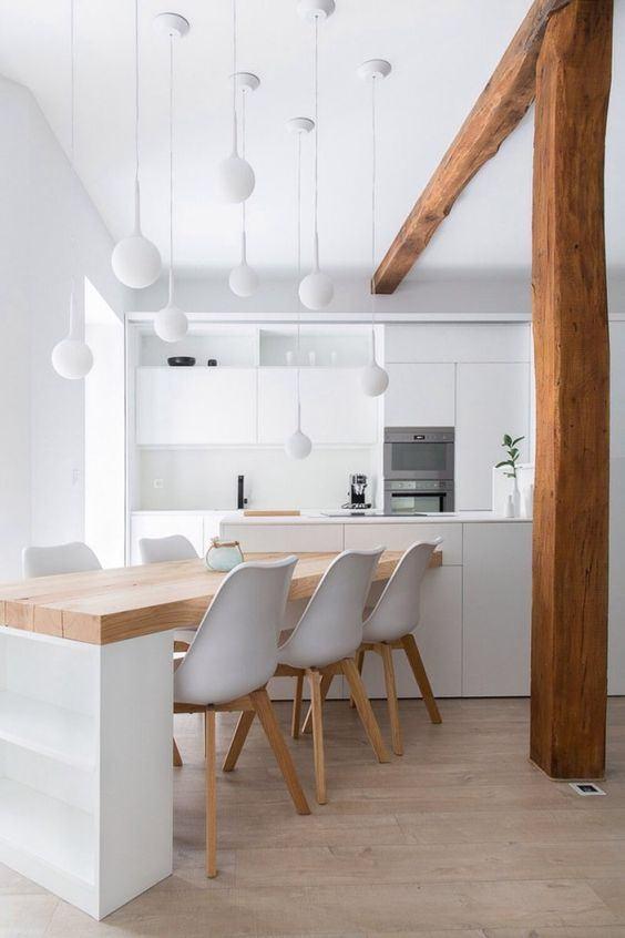 As estruturas aparentes quebram a predominância do branco na cozinha