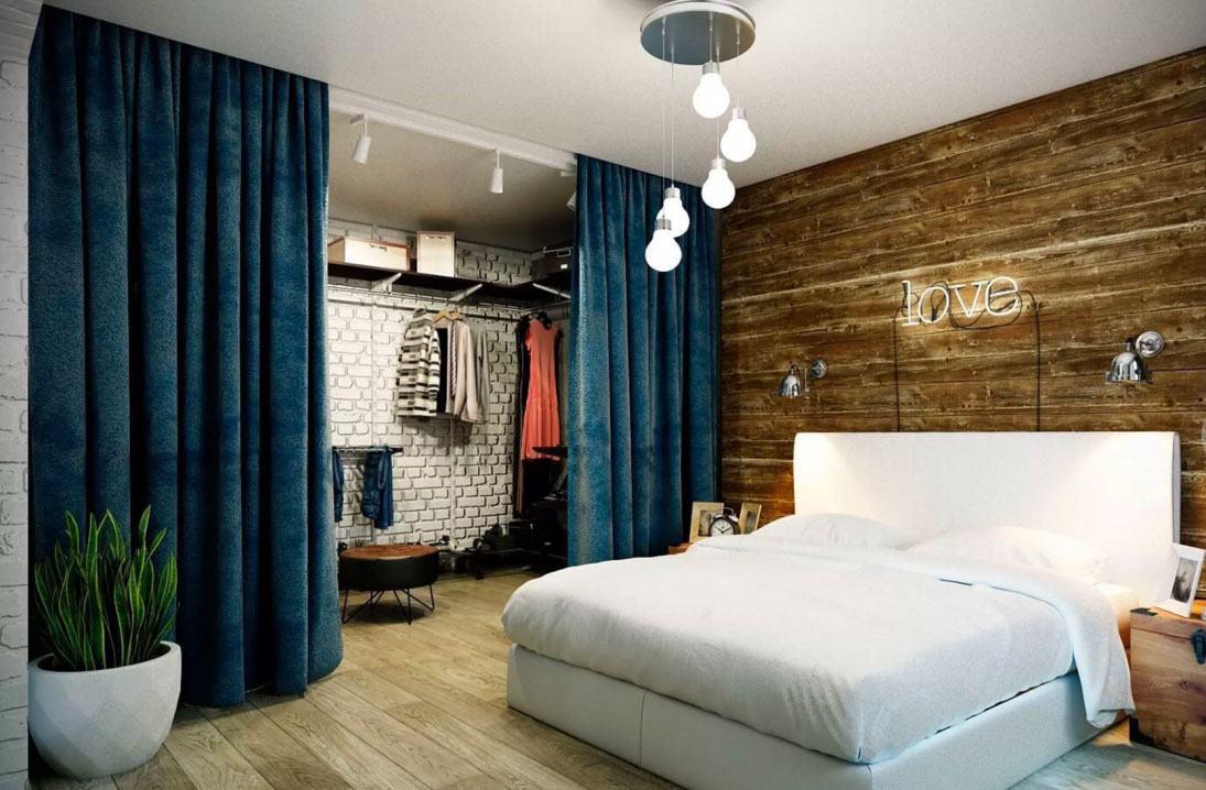 Para este quarto a proposta foi utilizar um pendente com fios aparentes e lâmpadas em diferentes alturas.