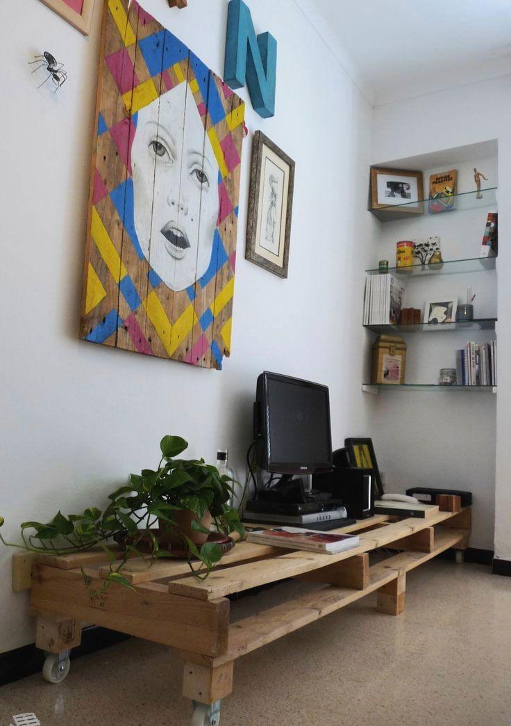 Quando o rack de pallet for baixo, faça uma composição de quadros na parede.