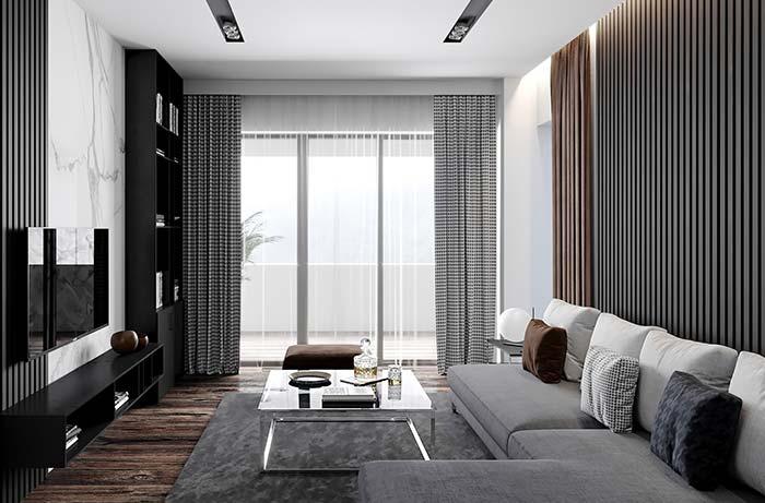 Estampa preta e branca da cortina a coloca como um elemento marcante da decoração