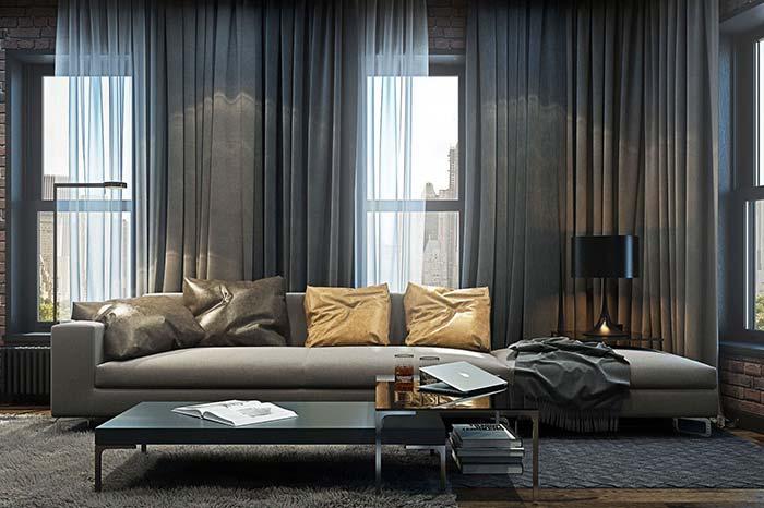 Para uma sala aconchegante e acolhedora, invista em uma cortina de tecido encorpado e que regule a entrada de luz