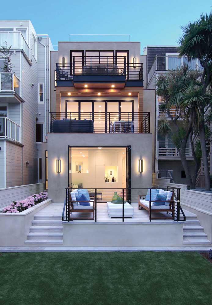 Arandelas externas para a entrada da casa moderna; o projeto de iluminação fica completo com os spots