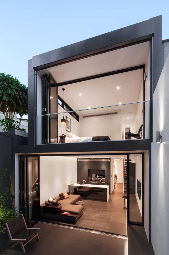 Arandela externa moderna acompanhando o estilo da casa