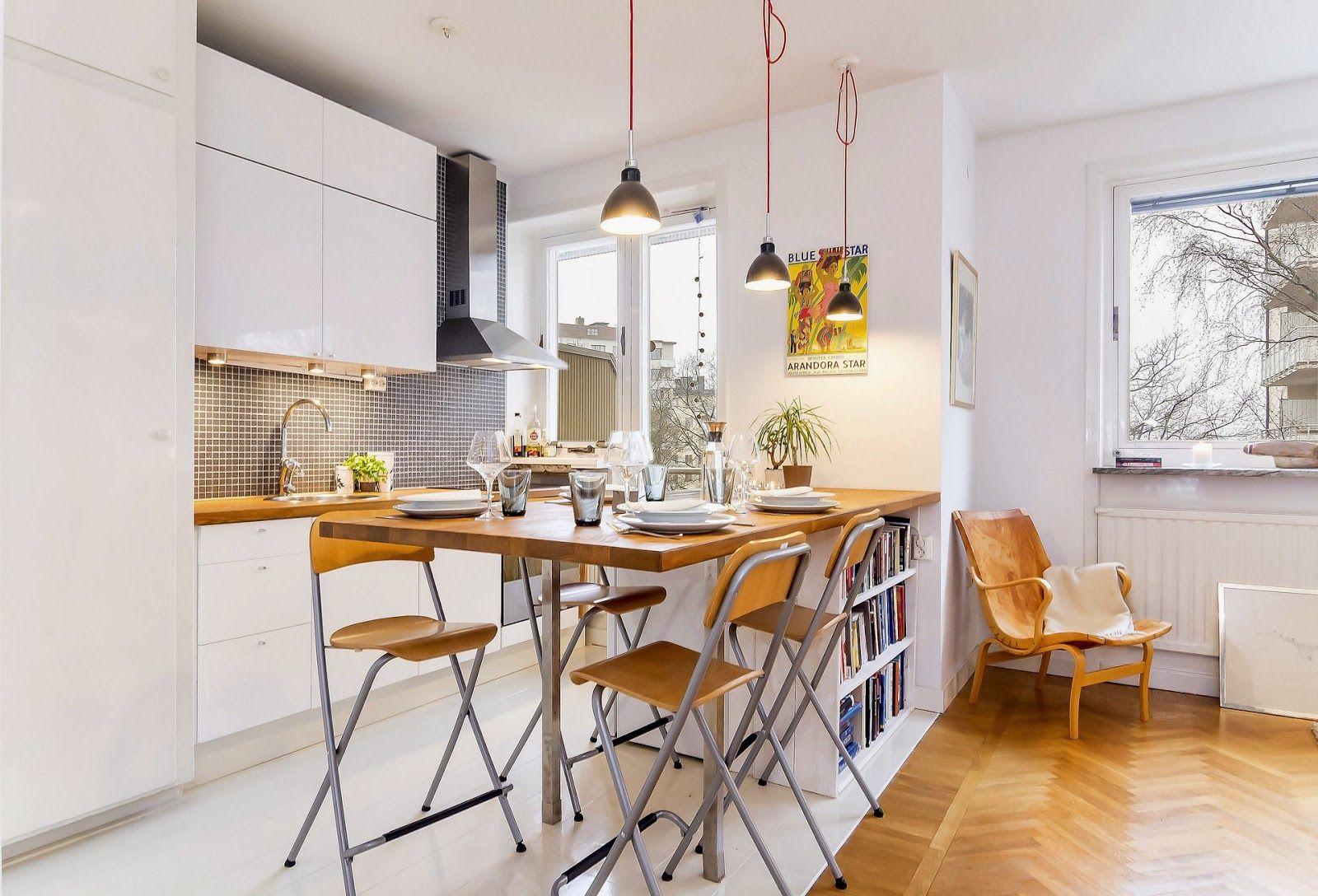 Utilize a bancada que integra os ambientes como uma mesa de jantar.