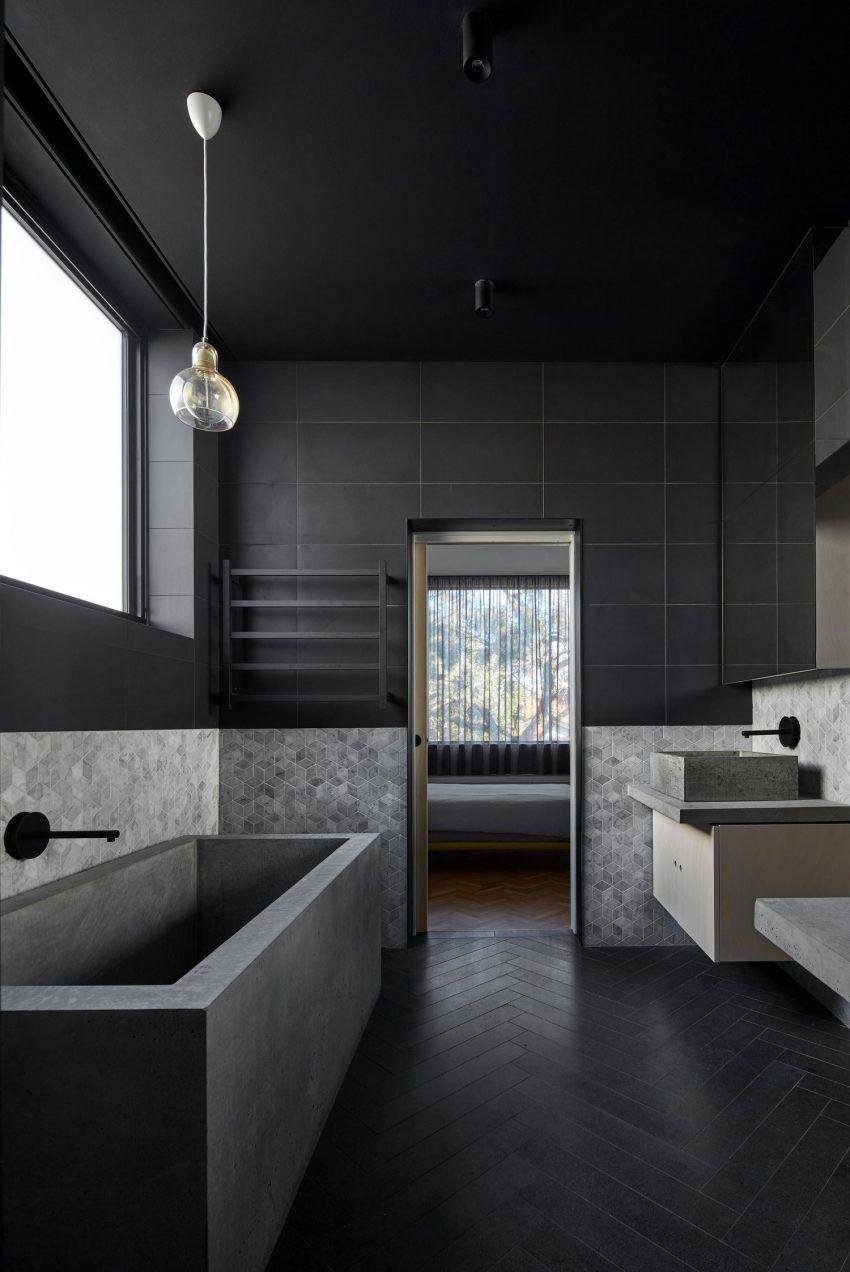 Banheiro decorado com preto e cinza