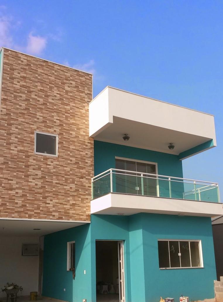 Cores de casa com fachada azul turquesa